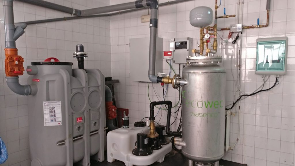 Demo 2 - Ecowec heat recovery system with waste water grease separator tank and waste water pump station. Installed and ready for test
